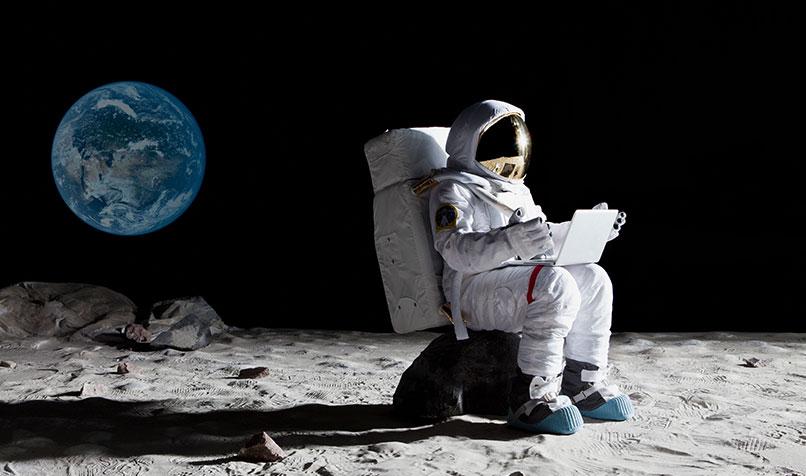 astronaut-sitting-moon-laptop